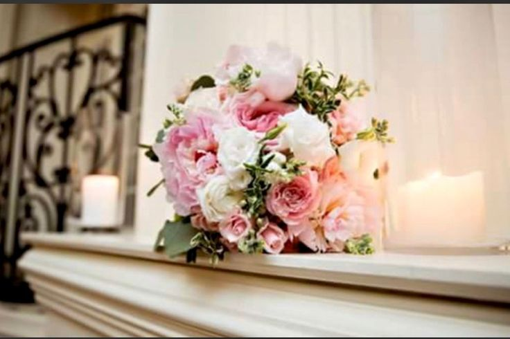Jen carried a bouquet of peonies, ranunculus, garden roses, and lisiantus for her wedding at Cesacphe Ballroom.