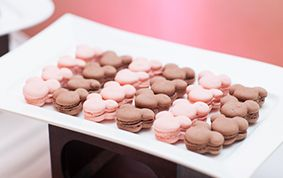 Pink and brown Mickey Mouse macarons at Disney wedding reception