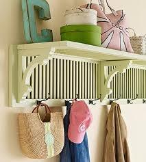 use an old shutter closet door, some wooden brackets and  make this shelf/rack