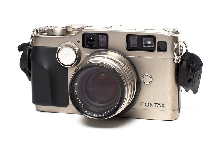 Contax G2 - If you want an autofocus film camera with amazing glass you can take anywhere with you, this is it. Produced from 1996 to 2005 as a rich man's travel camera, this is the world's most advanced rangefinder camera. It was designed to be used by anyone, simply point and click. While you can get several different lenses for it, the 45mm f/2 is really all you need (well, maybe a 28mm f/2.8 for those wider shots).