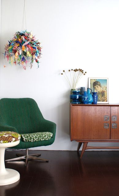 love this light and the green chair. plus the midcentury modern cabinet.