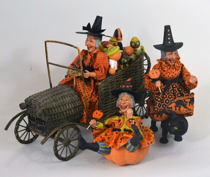 A Halloween Witch In A Wicker Car
