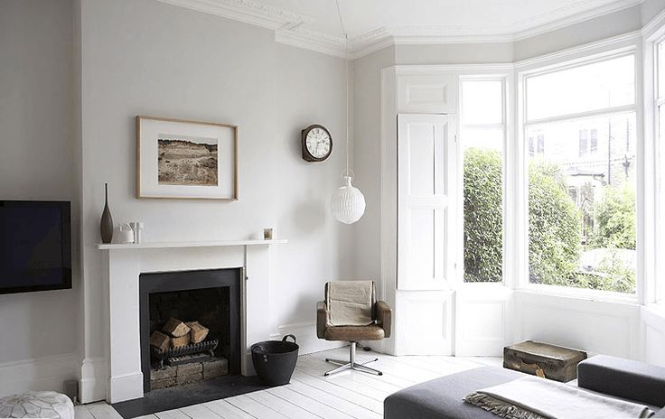 Light, bright home with painted white floors and light grey (gray) walls. whites, and greys (grays), nice combo throughout