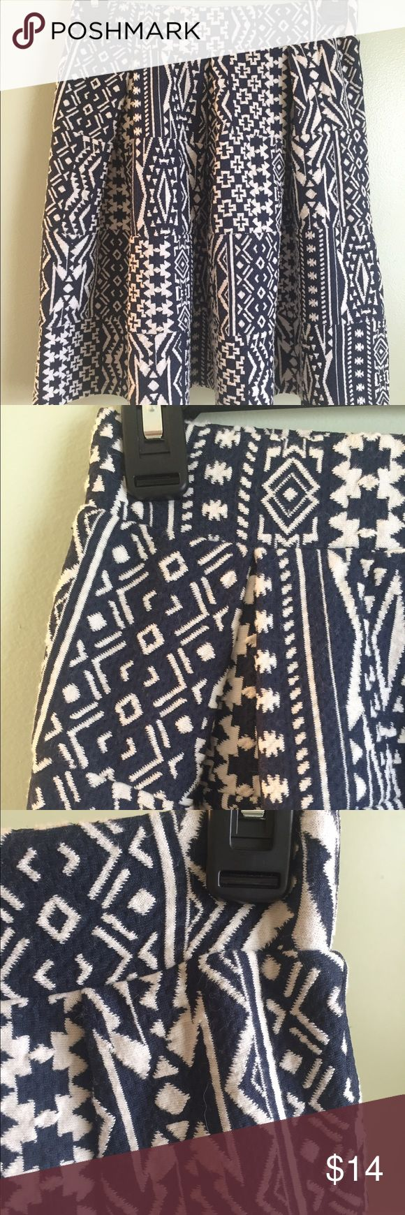 Xhiliration blue and white skirt.No tag/never worn XS blue and white skirt. Thick material (perfect to pair with tights). Can be pulled up to wear as a high waisted skirt or worn at hip level. Received as a Christmas present but have never worn it. Xhilaration Skirts