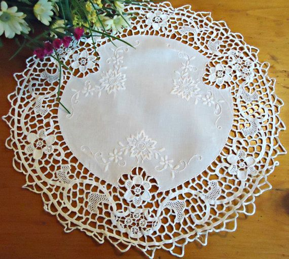 For your consideration is a beautiful white doily with an embroidered white cotton center accentuated with Cluny lace.    Measurements: SEE