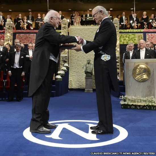 Peter Higgs (L) of Britain receives his Nobel Prize in Physics from Sweden's King Carl Gustaf during the 2013 Nobel Prize award ceremony in ...