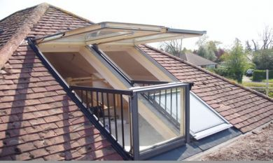 The roof at the back is almost exactly like this. Not the prettiest way to do it, and the way the window hinges at the pivot point looks like a recipe for disaster, but maybe a mini balcony would be a good idea?