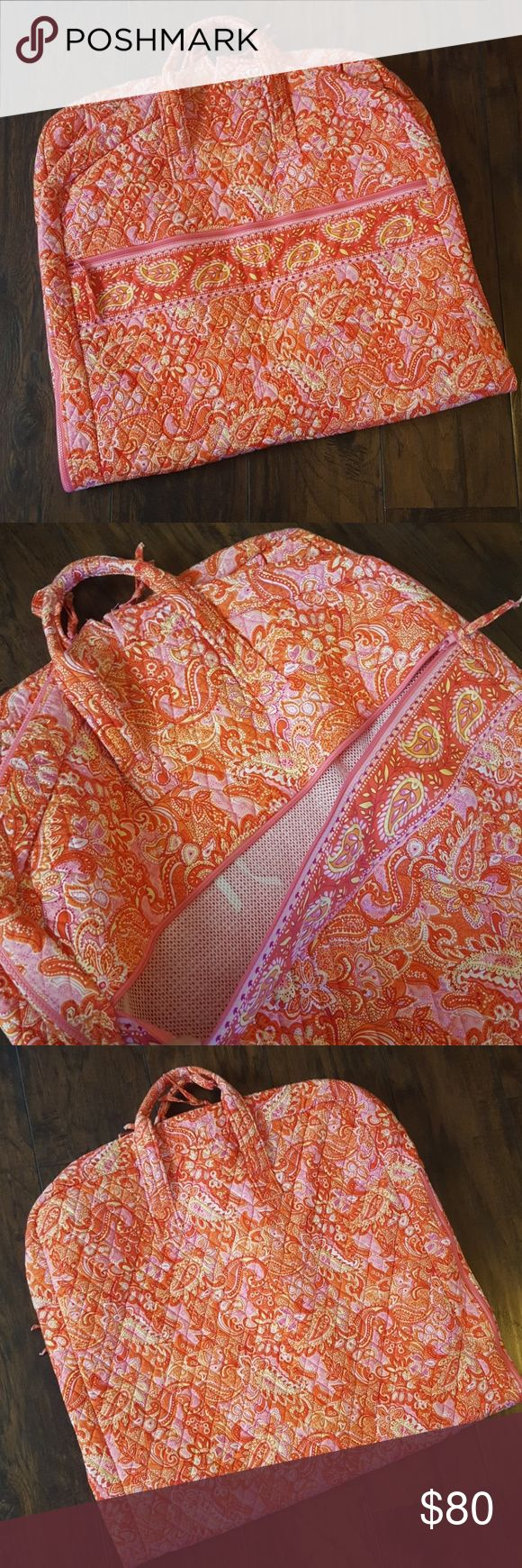 Vera Bradley garment bag in pink sherbet paisley Vera Bradley pink and orange paisley garment bag.  This bag is basically NWOT.  Only used once for a weekend trip.  Selling because I no longer have use for it. No rips, stains, tears.  Excellent condition.  Paid $130 at Hallmark. Vera Bradley Bags Travel Bags