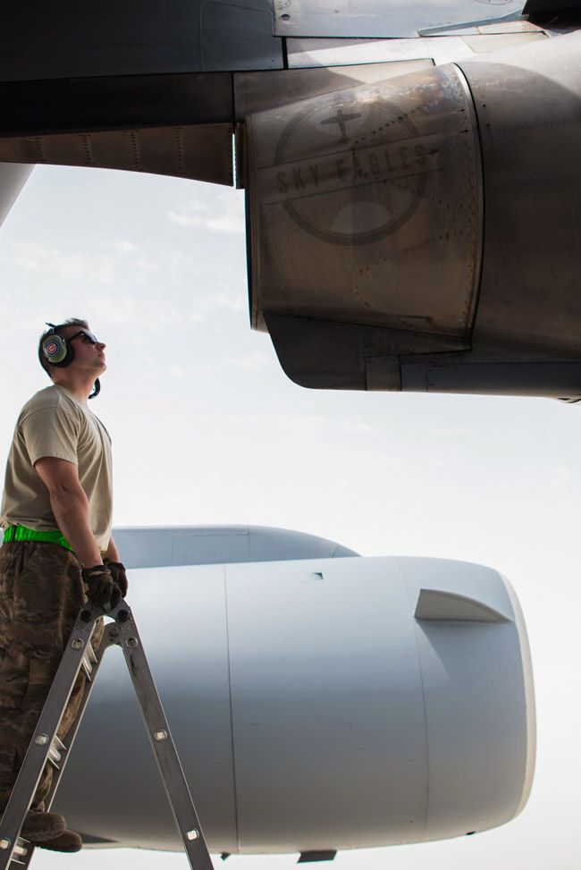Eric Pashnick, 5th Expeditionary crew chief, inspects an