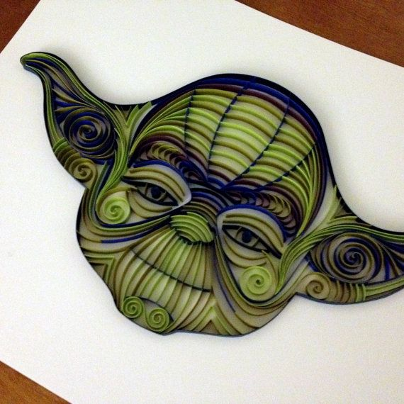 Original art! Quilled Yoda, made from .25 strips of paper, glued down. Each piece is made-to-order. The dimensions of his head are approximately 12.5W