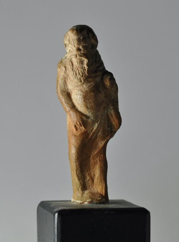 Greek pottery statuette of a satyr, 3rd century B.C. Greek pottery statuette of satyr with long beard, with hand touch his genital, 9.3 cm high. Private collection