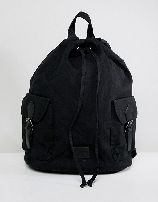 DESIGN duffel backpack in black with front pockets and internal laptop pouch