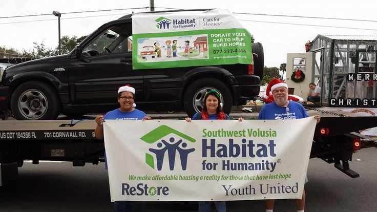 Cars for Homes supporters at Southwest Volusia HFH showcased a donated car in a local parade!