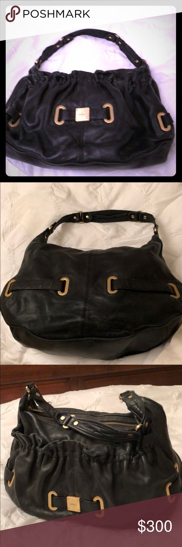 Botkier black leather handbag Super soft Botkier leather slouchy style handbag from Sacks Fifth Avenue. zipper top. Outside and inside pockets. Gold and leather accents Botkier Bags