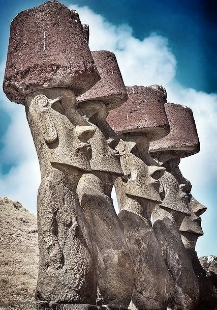 Some of the statues at Easter Island in Chile have hats on their heads.
