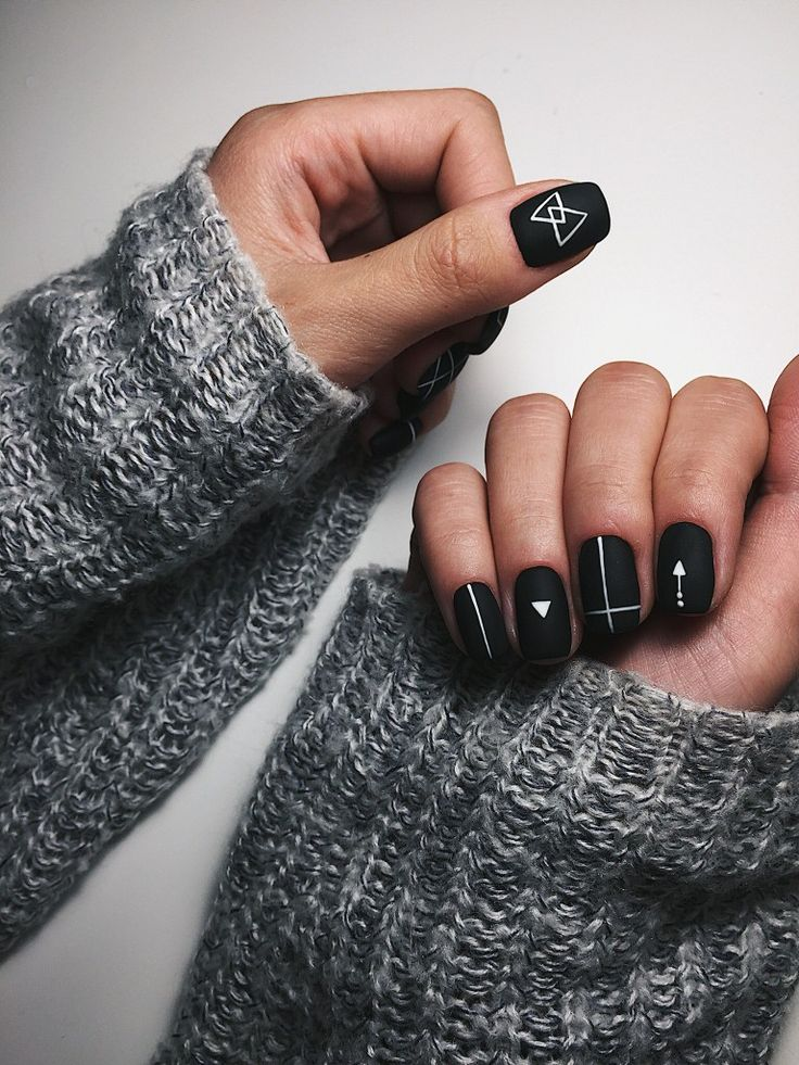 Black matte nails with geometric white line designs.  ― re-pinned by Breanna L. ~Follow me and never miss a new nail design!~