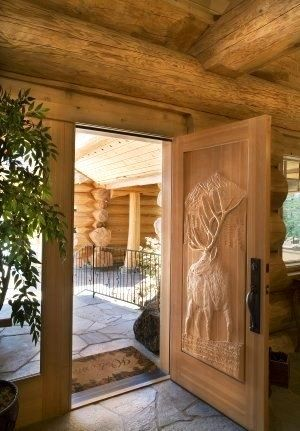 Pioneer Log Homes BC Canada   ♥ the Carved Detail in the Door #Timber Kings