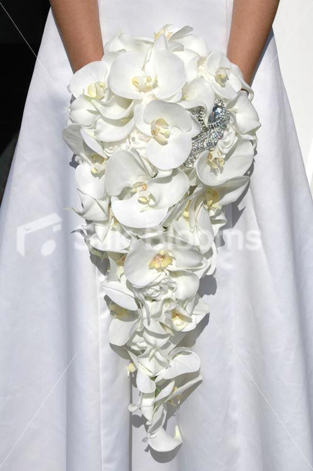Pure white phalaenopsis orchid cascade bouquet with brooches (Silk Blooms Top 10 Orchid Bouquets) #wedding #flowers #whie #orchids #brooch #cascade #silk #artificial