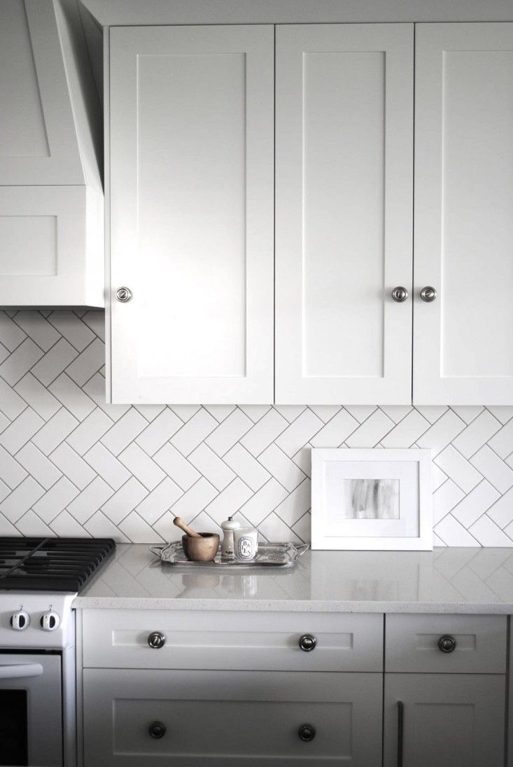 Subway tiles take on a fresh look when they're laid in a herringbone pattern that runs diagonally.: