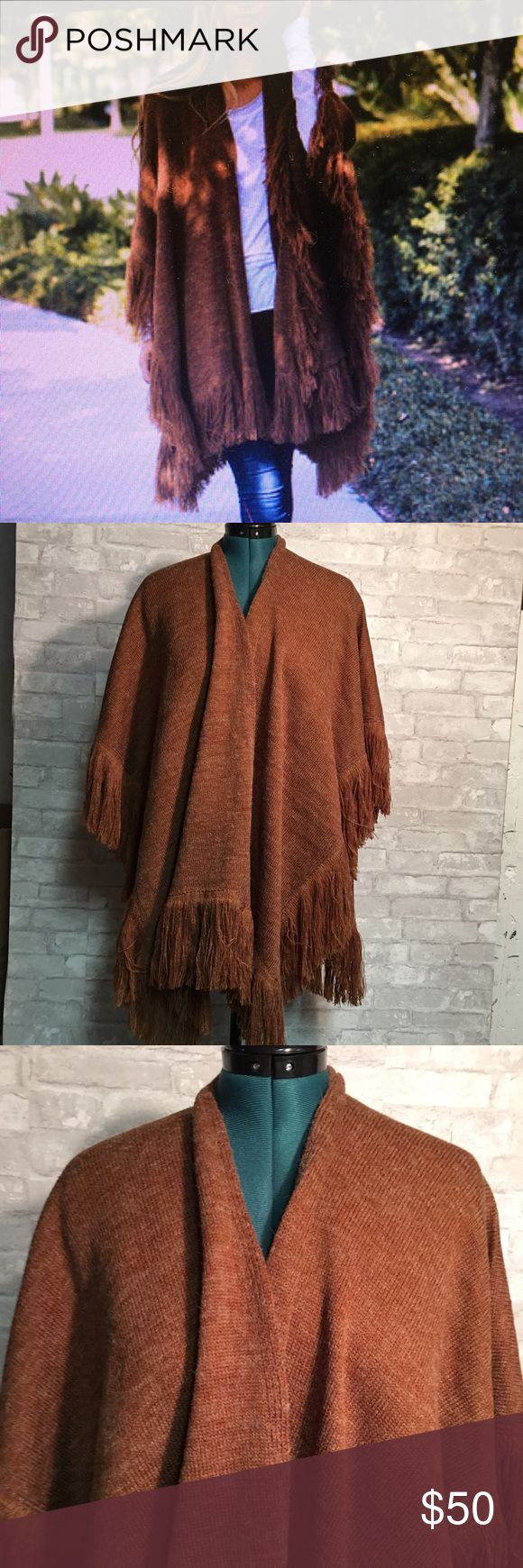Camel heathered Poncho Camel heathered Poncho. One size fits all, fringed hemline. Fabric is 50% polyester/ 50% Acrylic. Sweaters Shrugs & Ponchos
