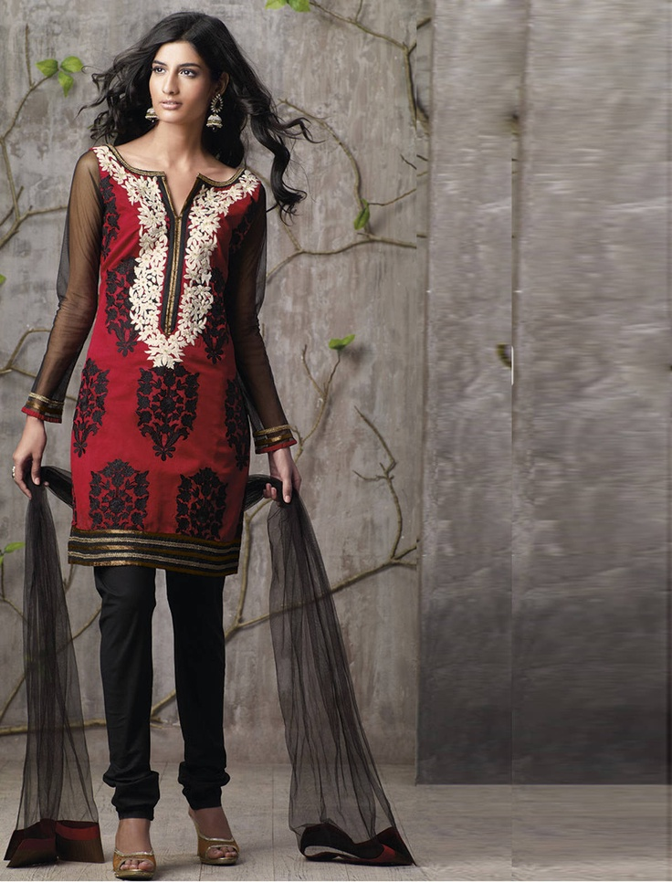 DIVYA KANAKIA / NOIR NECK:  Step out in this captivating churidar suit and be ready to handle the attention.    Modernization catches the eye of all, specially when you wear this Red and Black Cotton churidar kameez.    You will be a center of attraction in the wedding, this ready made kameez being adorned with beads, stone and patch work.