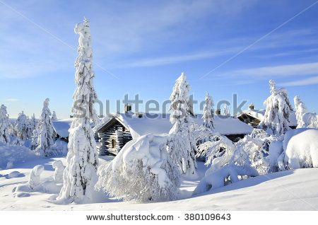 Cottages on snowy mountain on a sunny winter day - stock photo