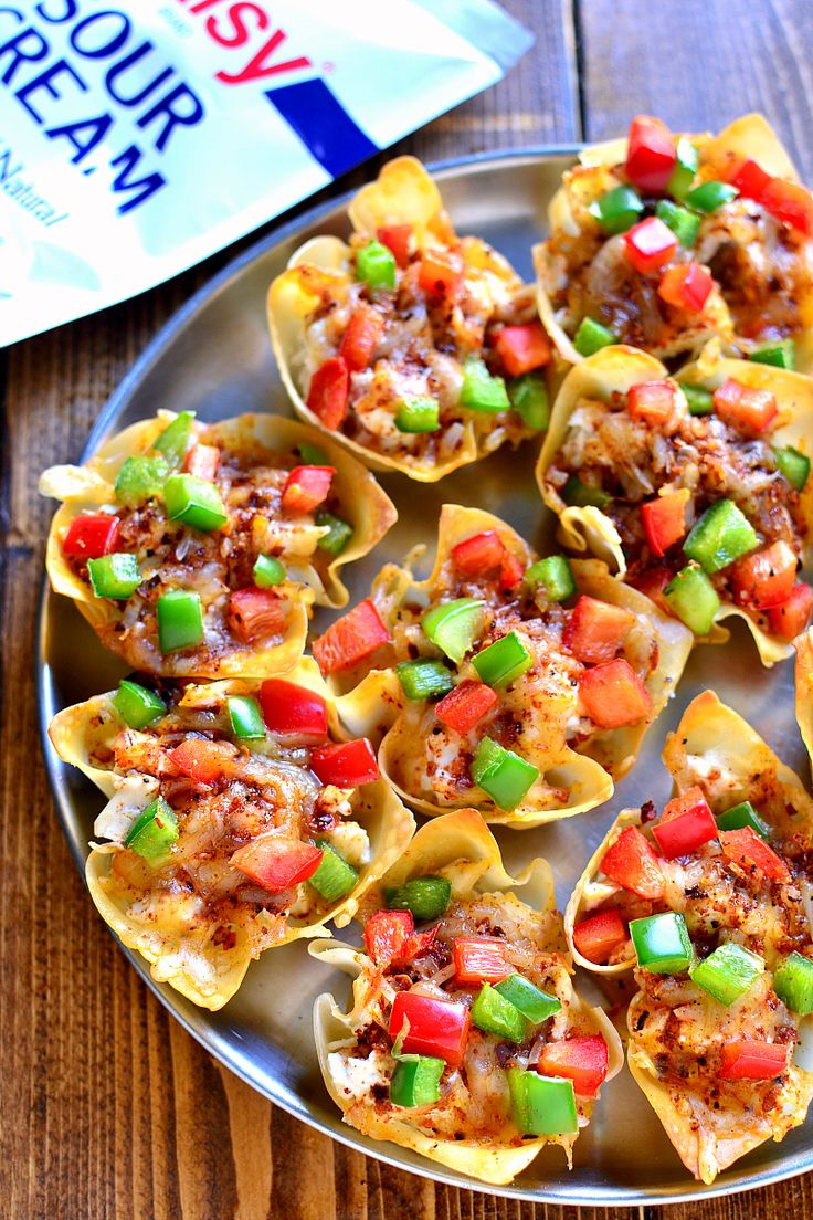 Southwest Chicken Wonton Cups are loaded with creamy chicken, cheese, and peppers and packed with delicious southwest flavor. The perfect holiday appetizer - sure to become a new family favorite! #ad