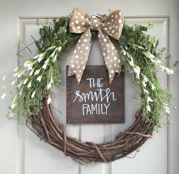 This friendly and rustic wreath is easy and adaptable to all seasons! Its a classic every day wreath that comes with your family name on a barn wood sign as an insert that hooks. The wreath is made of twigs, greenery, eucalyptus, and white flowers. To complete the look we have a burlap white polka dot bow. Hows that for a first sight of your home upon a guests entry?