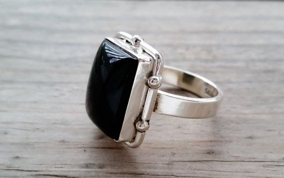 This is a classic and stunning 925 sterling silver ring with rectangular cut genuine black onyx. 925 stamp inside the ring band  Ring face