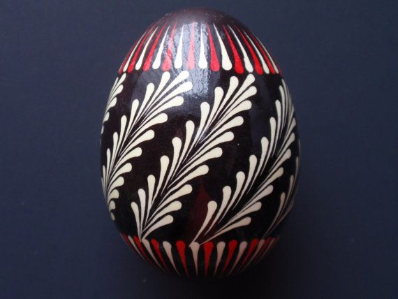 This pysanka was made in the traditional wax-resist process on a real blown chicken egg. It is decorated using the pinhead method also known as the