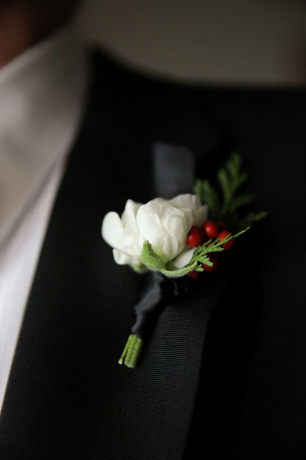 Elegant winter boutonniere (Photo by Logan Walker Photography)