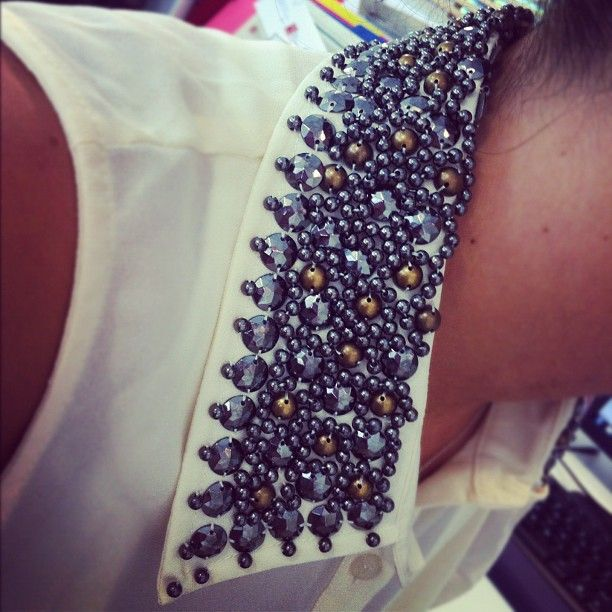 Absolutely obsessed with the hardware on @mollychudnovsky's collar! #fashion #studs
