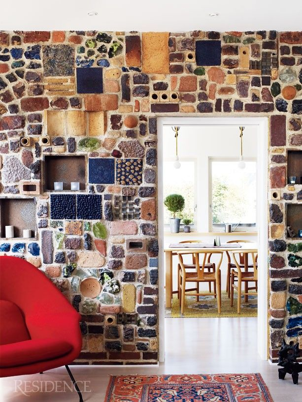 Mosaic wall with found objects.
