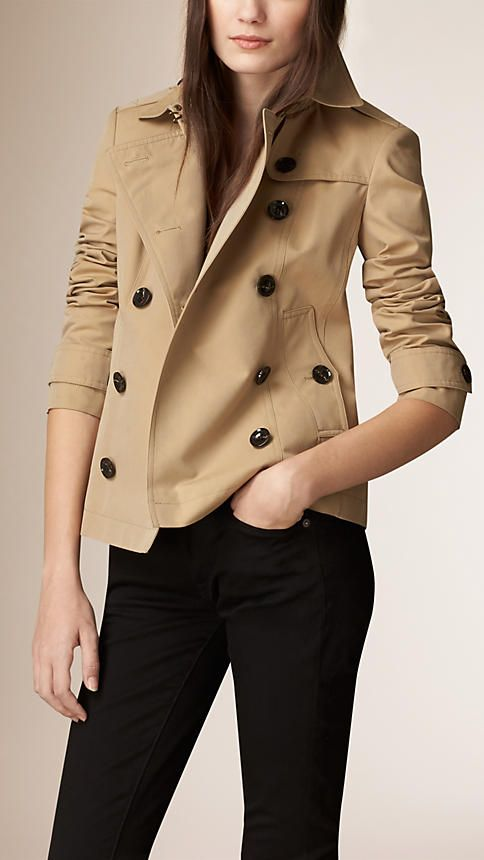 Burberry Honey Cotton Poplin Trench Jacket - A showerproof cotton poplin trench jacket. The closely cut double-breasted design features set-in sleeves and a pleated skirt. Heritage details include epaulettes and a gun flap. Discover the women's outerwear collection at Burberry.com