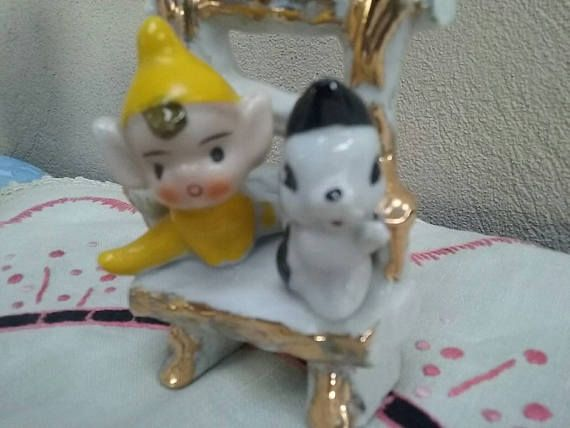 Check out this item in my Etsy shop https://www.etsy.com/au/listing/531989891/vintage-pixie-elf-and-skunk-on-a-chair