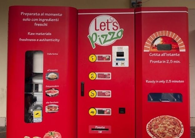 """Pizza Vending Machine In Europe Let's Pizza serves 10.5"""" """"fresh"""" pies 24 hours a day for $6 each. The machine kneads the dough, sauces the pizza, adds toppings (you have a choice of three), and heats pizza in an oven in less than three minutes. 