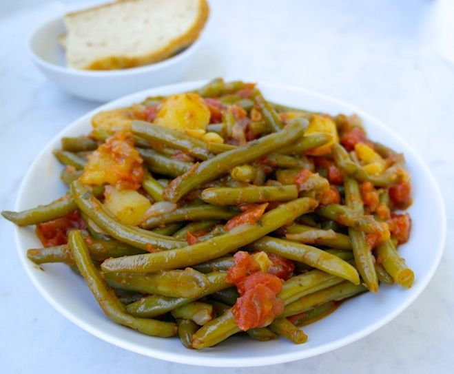 The ultimate Greek summer food. Softly cooked green beans in rich olive oil.