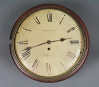 """Lot No 741,  A Victorian fusee wall clock with 12"""" painted dial and Roman numerals, inscribed Russell Halifax, contained in a circular mahogany case, sold for £400"""