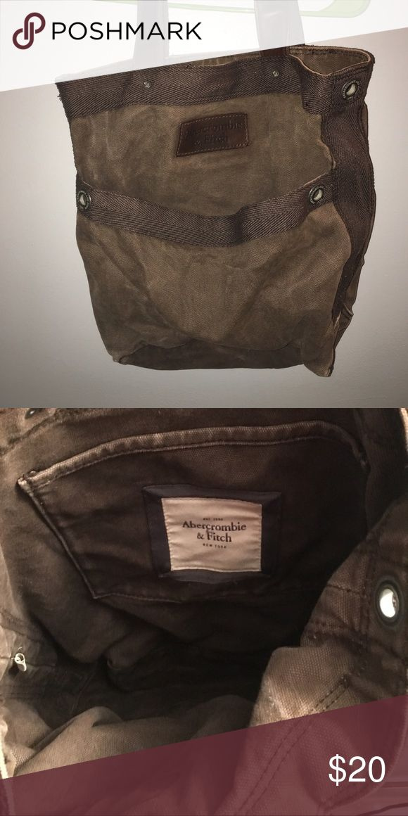 Brown Abercrombie and fitch shoulder bag. Good used condition. Still has life left. Great for carrying books on campus. Has divider pockets inside. Abercrombie & Fitch Bags Totes