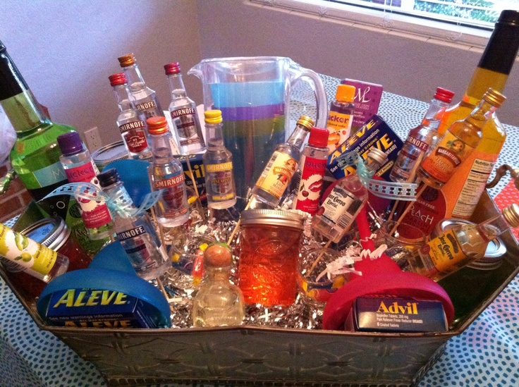 21st birthday basket! Every flavor of Vodka and Tequila at the store, small Mason jars filled with homemade Jolly Rancher Vodka, shot glasses, fun cup sets, and hangover medicine for the morning after!