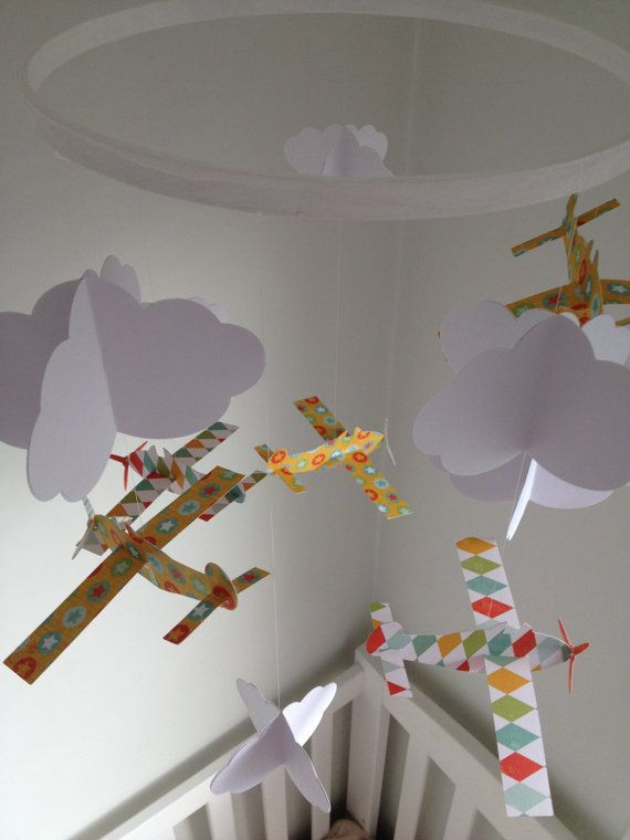http://www.etsy.com/listing/108914348/clouds-and-aeroplane-mobile-3d