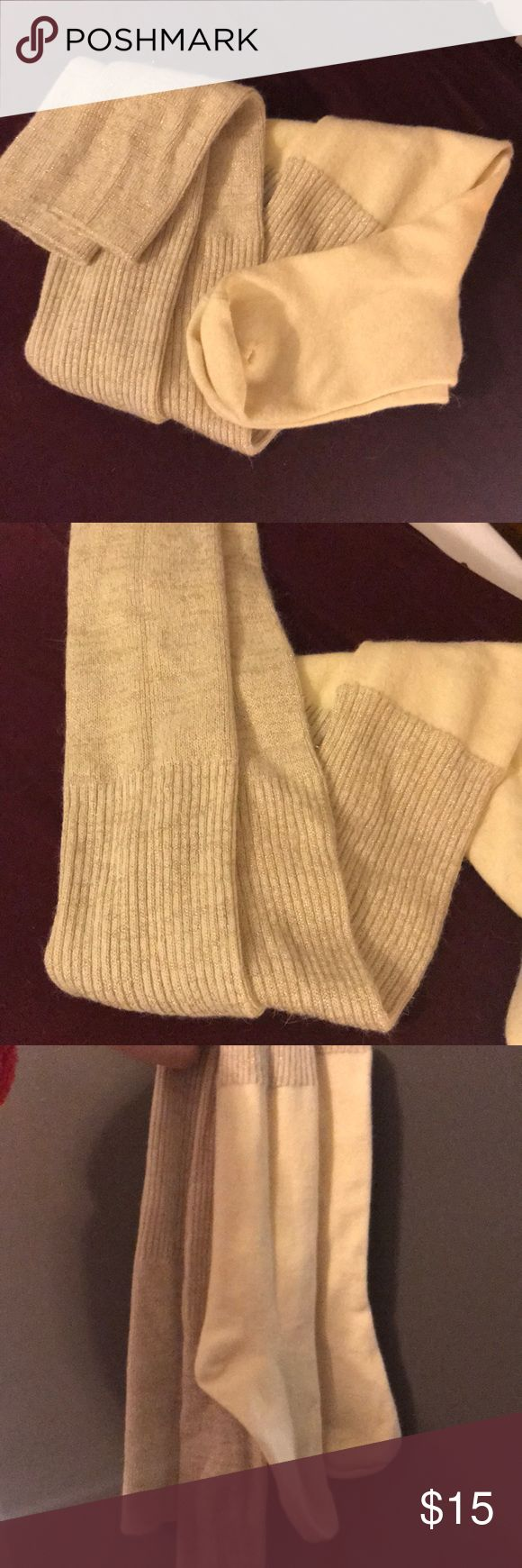 """Kate spade thigh high socks NWOT never worn Kate spade ribbed, color block over the knee glittery socks. They are a cream color at the bottom and a gold textured weave at the top.   """"Contrasting color and texture plays up the trendy blocked patterning of wool-kissed socks that can be worn soft and slouchy or pulled up over the knees.""""  Rayon/wool/nylon/polyester/other fibers/spandex; hand wash. kate spade Accessories Hosiery & Socks"""