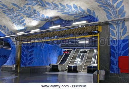 STOCKHOLM, SWEDEN - AUGUST 08, 2013: Escalators on T-Centralen station on the Blue Line, designed by Per Olof Ultvedt - Stock Image