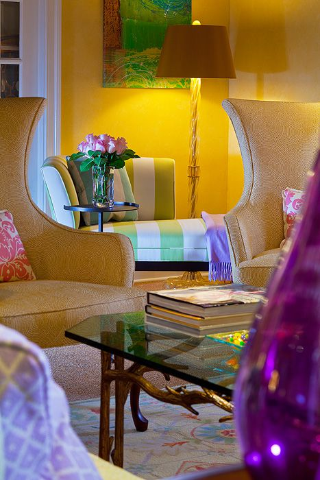 You want to catch the eye of the viewer...add a brightly colored glass object!! What a beautiful space and a fantastic photographic angle.  Really enticed me anyway.