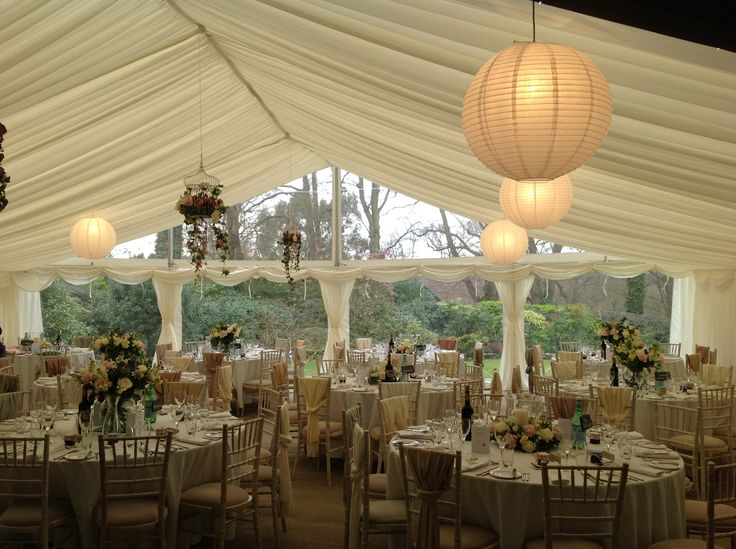 Beautiful multispan wedding marquee with stunning panoramic window and floral birdcages. https://www.facebook.com/southernmarquees/posts/897437626945220