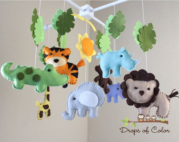 HELLO AND WELCOME TO DROPS OF COLOR! Add a drop of color to your life by decorating your baby room with this gorgeous mobile. **PLEASE READ everything before making your purchase for all details and questions. Thanks!  ~DETAILS~ A Made to Order Mobile BIG Safari mobile with many animals such as Tiger, Lion, Elephant, Hippo, Monkey, Giraffe and more with safari leaves in a wood frame hanger. A lovely original design made by Drops of Color ©  Each mobile is hand made from scratch, hand-cut…