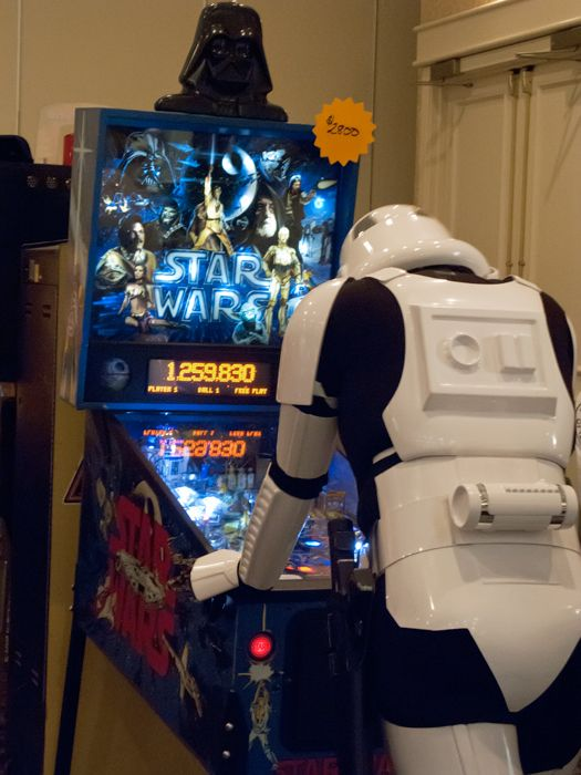 Stormtrooper playing pinball off-duty.