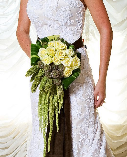 Beautiful collared bouquet with clustered cascade. Texture is wonderful.