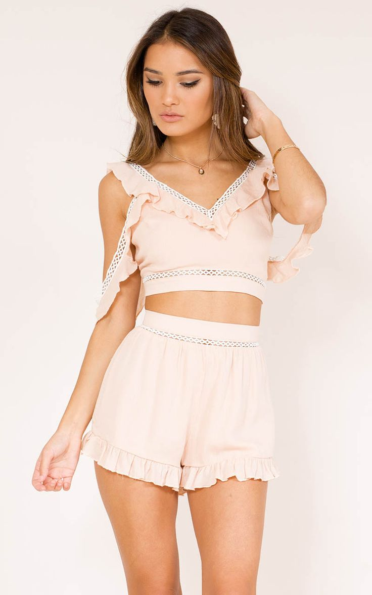You won't be having any more boy trouble when you look this good! This gorgeous two piece set features a crop top with a V-neckline and the bottoms also have an intricate trim and cute ruffles.