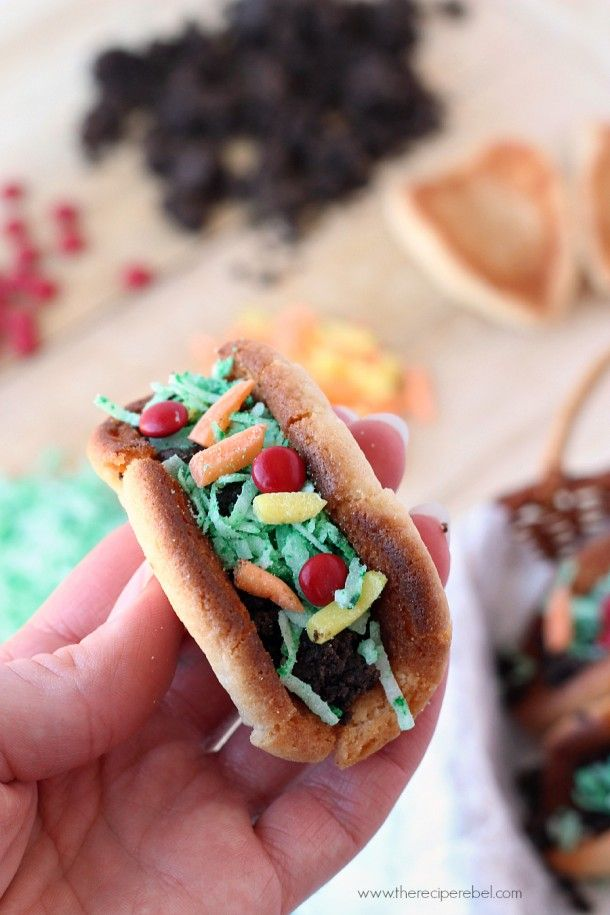 """Sugar Cookie Tacos: a sugar cookie """"taco shell"""" stuffed with Oreo """"meat"""" and topped with all the fixings. Perfect for a party or Cinco de Mayo!"""